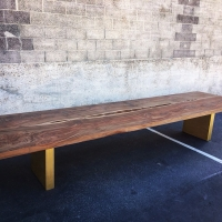 15' long claro walnut dining table on custom steel legs with hand rubbed bronze finish
