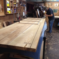 Five plank teak dining table with angled kerf joints