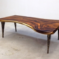 Natural edge coffee table with custom cast bronze legs
