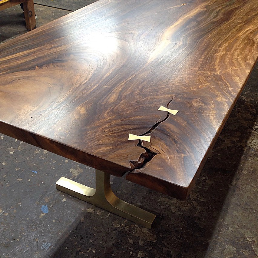 Wood Slab Dining Tables with metal table legs.