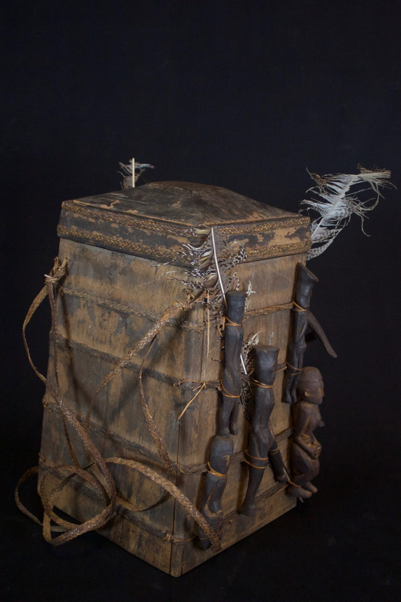 """'Lupong Manang' or Shaman's Medicine Carrier/Backpack with Healing Amulet/Fetish Figures (rare), East Kalimantan, Borneo, Indonesia, Dayak tribe, Late 19th to early 20th c, Wood pigmented with soot, raffia, feathers, porcupine quill. Shaman made their own medicine kit backpacks to carry items for healing, protection and predictions such as special teeth, stones and other items. The healing amulet figures on the exterior correspond to illnesses and other conditions. 17"""" x 12 ½"""" x 15"""", $3,900. (see previous image of front side)"""