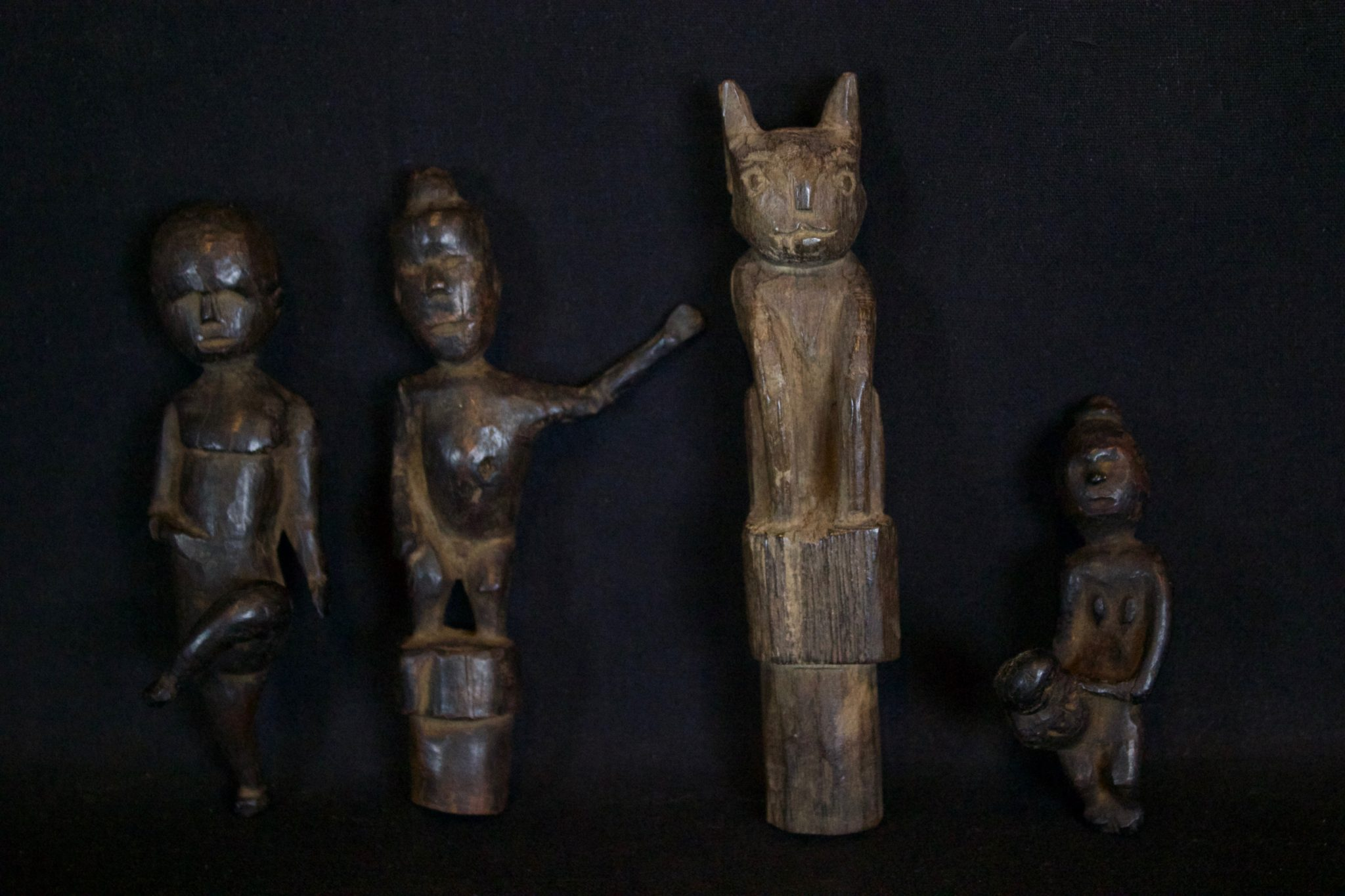 "Shaman's Amulet/Talisman Figures for Healing, Kalimantan, Borneo, Indonesia, Dayak tribe. Dimensions/Info Left to Right: (Early 20th c. Wood, 4 ¾"" x 1 ½"" x 1 ½"", $90.); (Late 19th to early 20th c, Wood, 5"" x 2 ½"" x 1 ½"", $90.); (Mid 20th c, Wood, Stopper for shaman's medicine container, 5 ¾"" x 1"" x 1 ¼"", $130.); ( Early 20th c. Wood, Used for healing a child, 3 ¼"" x 1"" x 1 ¾"", $85.)"