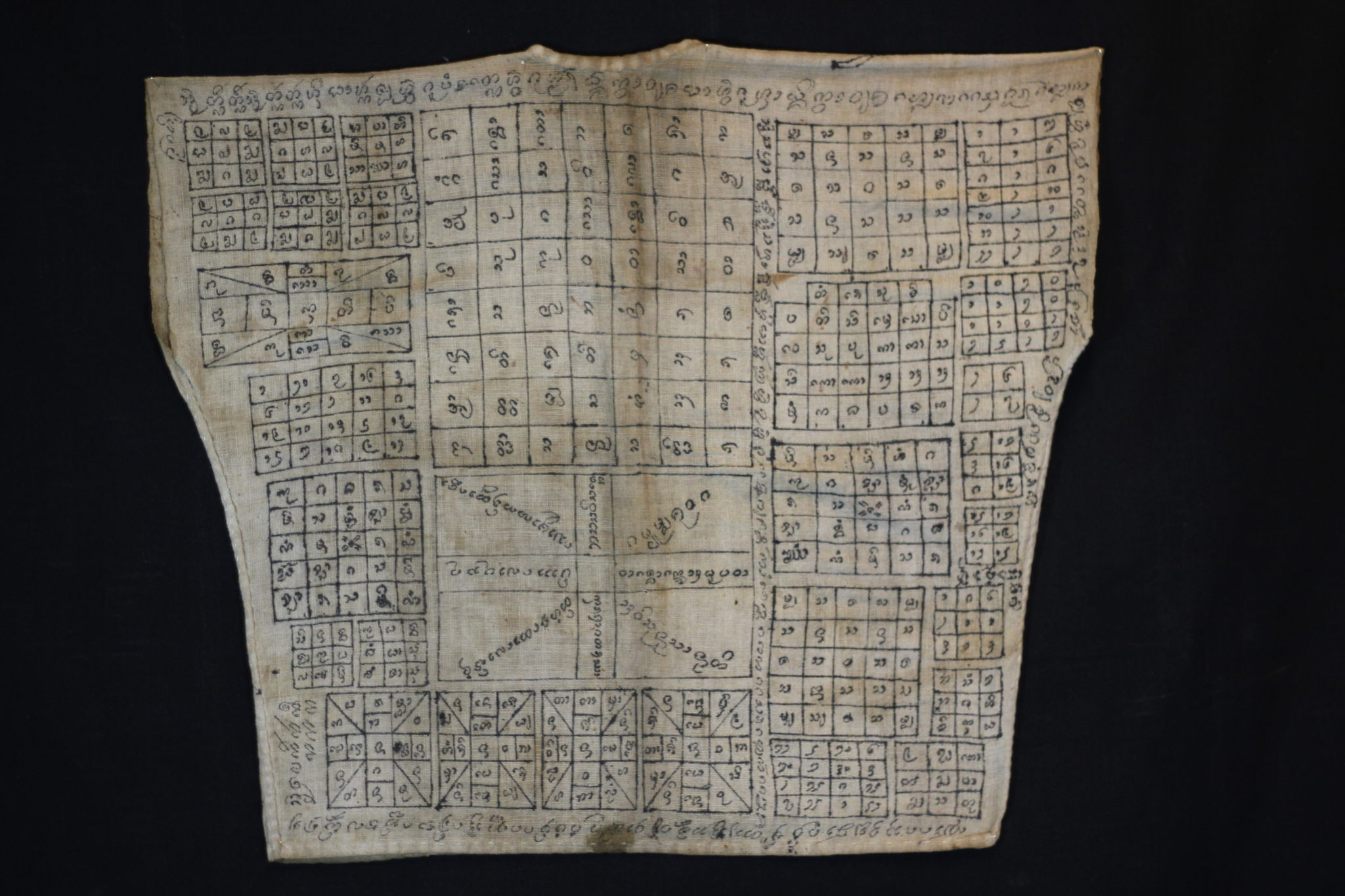 "Amulet Yantra Vest Nong Pho, Thailand Vietnamese shaman Mid to late 19th c. Cotton, pigment Handmade and drawn by the shaman It is endowed with prayers, signs, numbers and a depiction of the great guru monk Luang Phor Doem. The sacred cloth is an undergarment worn as a talisman with great protective power against physical harm, like bullets, spears, knives, wild animals and evil spirits. 19"" x 22"" $2,900."
