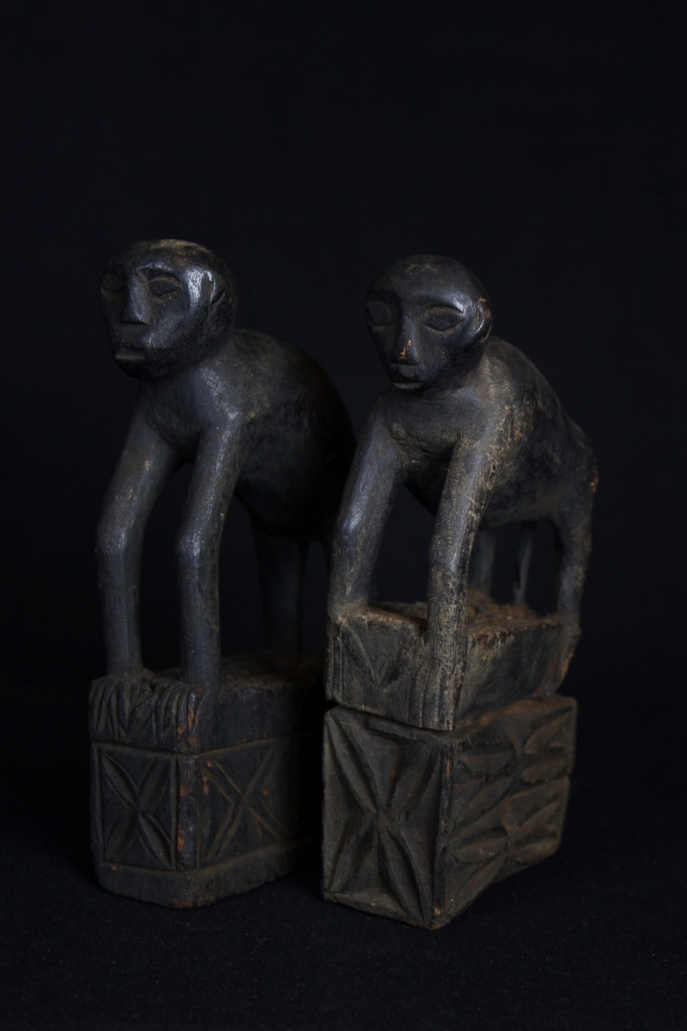 "Shaman Amulet/Talisman Figure (rare), Kalimantan, Borneo, Indonesia, Modang Dayak tribe, Early to mid 20th c, Wood with patina from use and age. Zoomorphic or monkey figure amulet. $650 (sold as pair) Dimensions"" (left - 7"" x 1 ½"" x 3 ¾""); (right - 7"" x 1 ½"" x ¾"")"