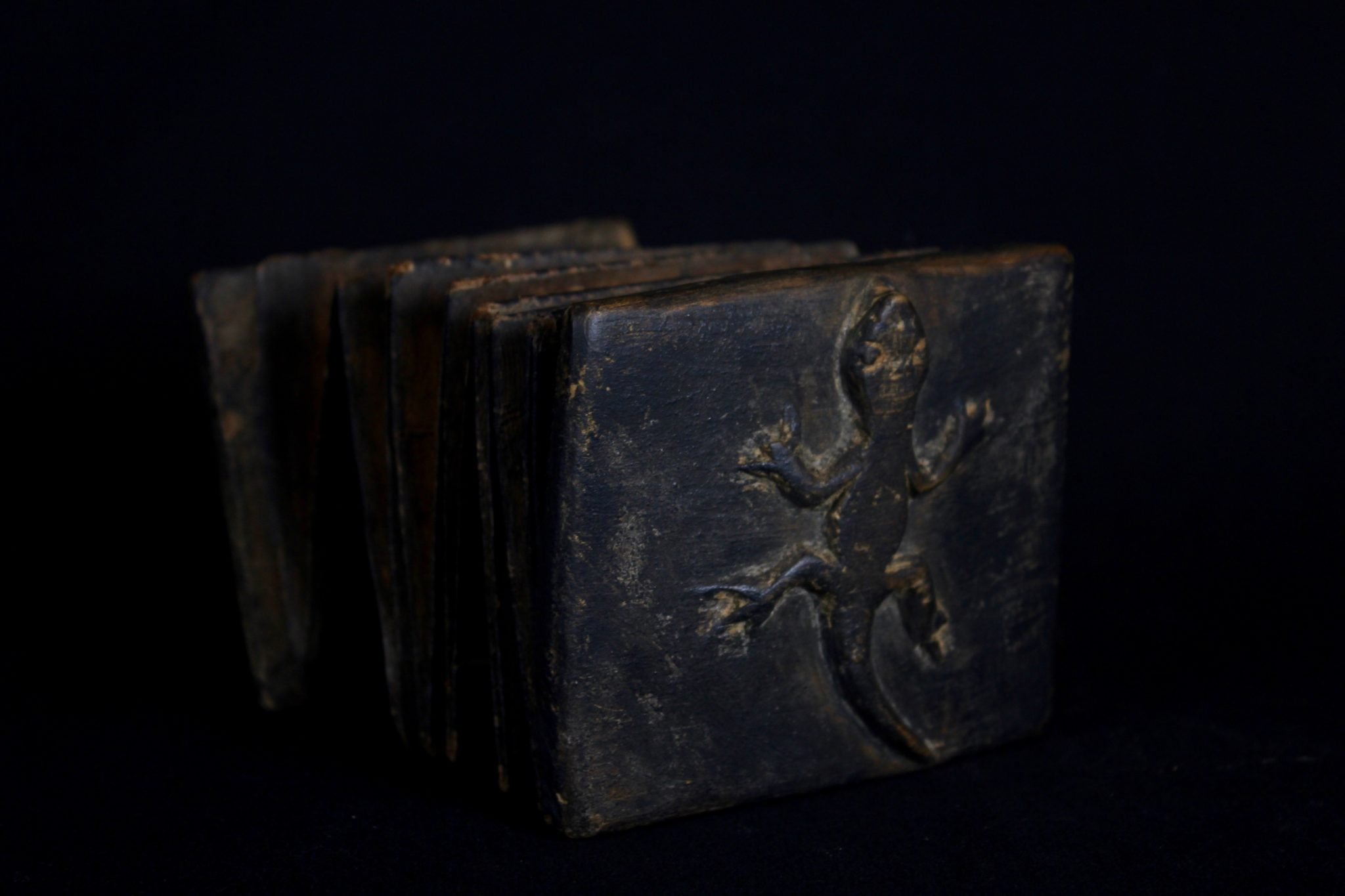 """'Pustaha' or Shaman Medicine Book, Indonesia, Sumatra, Batak tribe, Wood cover, bark pages and braided rattan band. Late 19th or early 20th c, The book unfolds like an accordion. It contains the shaman's magic formulas (tabas), oracles, recipes for medicines and instructions for performing rituals and for producing magic cures. It contains three main divisions of knowledge: the art of preserving life; the art of destroying life and the art of fortune telling. 4 ½"""" x 3 ½"""" x 2"""", $2200."""
