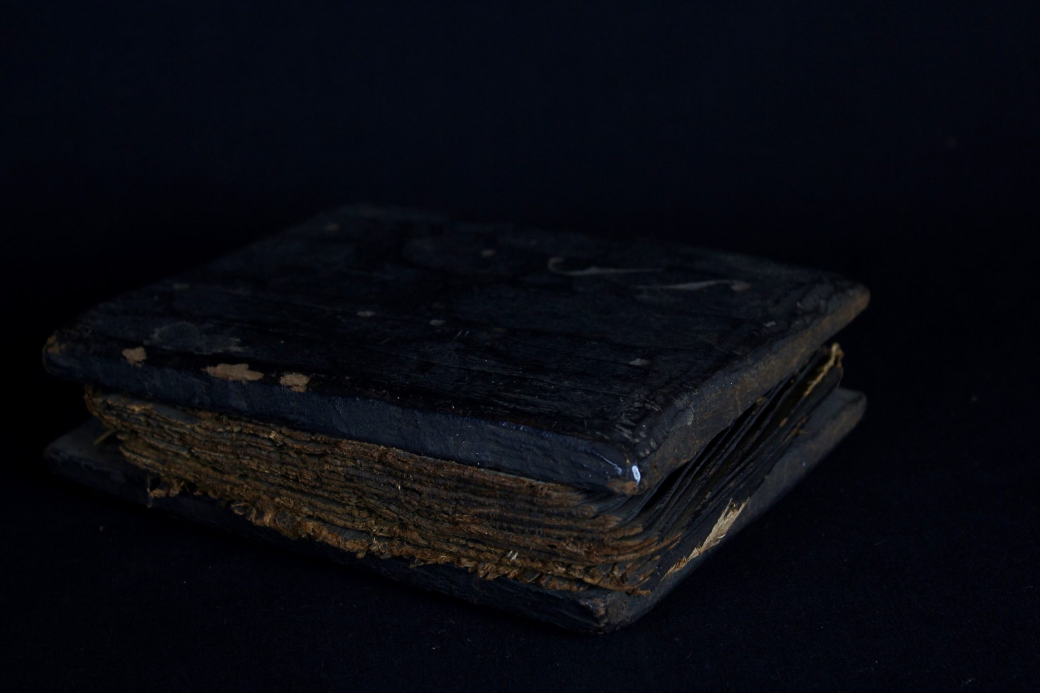 """Shaman's Medicine/Magic Book, Sumatra, Indonesia, Batak tribe, Late 19th to early 20th c, Wood cover, bark pages. The book unfolds like an accordion It contains the shaman's magic formulas (tabas), oracles, recipes for medicines and instructions for performing rituals and for producing magic cures. It contains three main divisions of knowledge: the art of preserving life; the art of destroying life and the art of fortune telling. 8"""" x 6 ½"""" x 2 ½"""",$3200."""