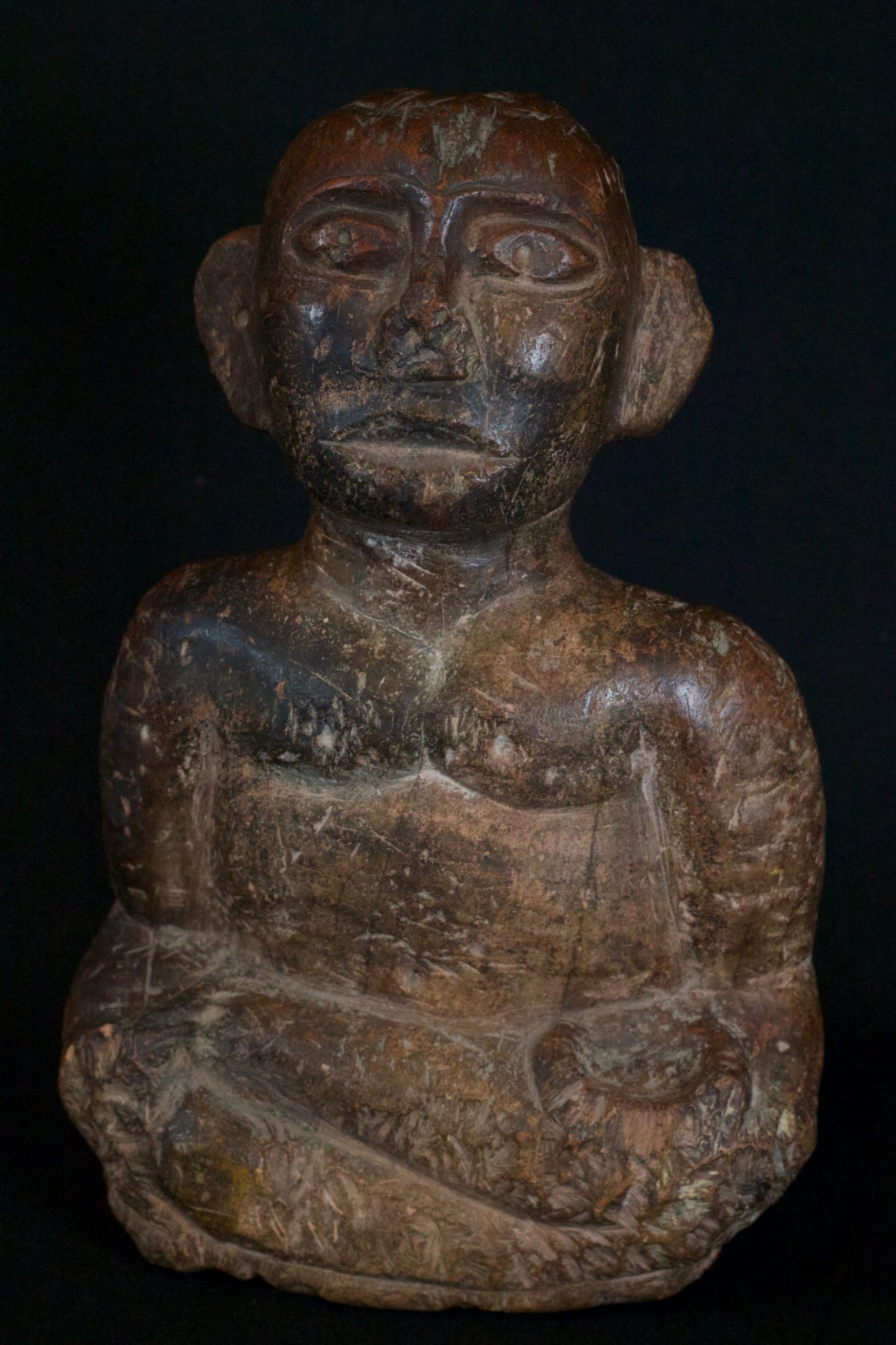 "'Pangulubalang' Shaman Figure (exceptionally rare), Sumatra, Indonesia, Batak, Simalungun, Mid 16th to 17th c, Stone, with patina They are specifically made by the shaman and embodied with a powerful spirit slave. They are used in conjunction with a magical substance, pupuk - a magical substance which is the embodiment of earthly suffering, destruction, hate and anger - which required special ingredients and a long and intricate preparation ritual. The purpose of this was to imbue the statue with the power to ward off evil spirits, to prevent disasters and as a dynamic healing tool. For healing, small bits of the statue itself were chipped off of corresponding body parts and made into a potion. 12"" x 7 ¾"" x 3 ½"", Price on request"