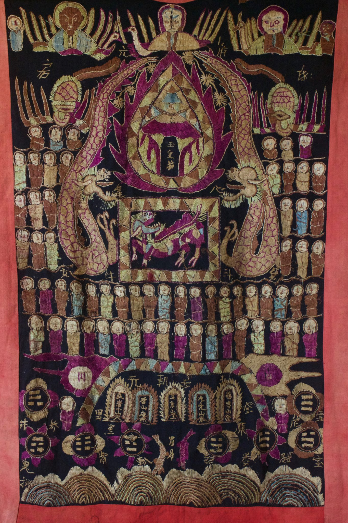"Dragon Robe/Ritual Cloak (back), Vietnam, Tao people, Early to mid 20th c, Cotton, silk embroidery. Worn only by high level priest/shaman for all ceremonies. The motif typically includes all the deities of heaven to clothe the shaman in the universe for protection. Not a vain adornment, it is a reminder of man's place in the hierarchical order. Originally a female costume. Long ago shamans were women and men the providers. Not being encumbered by childbirth and rearing, men replaces women as shamans but retained this part of the sacred costume. 48"" x 39"", $2700."