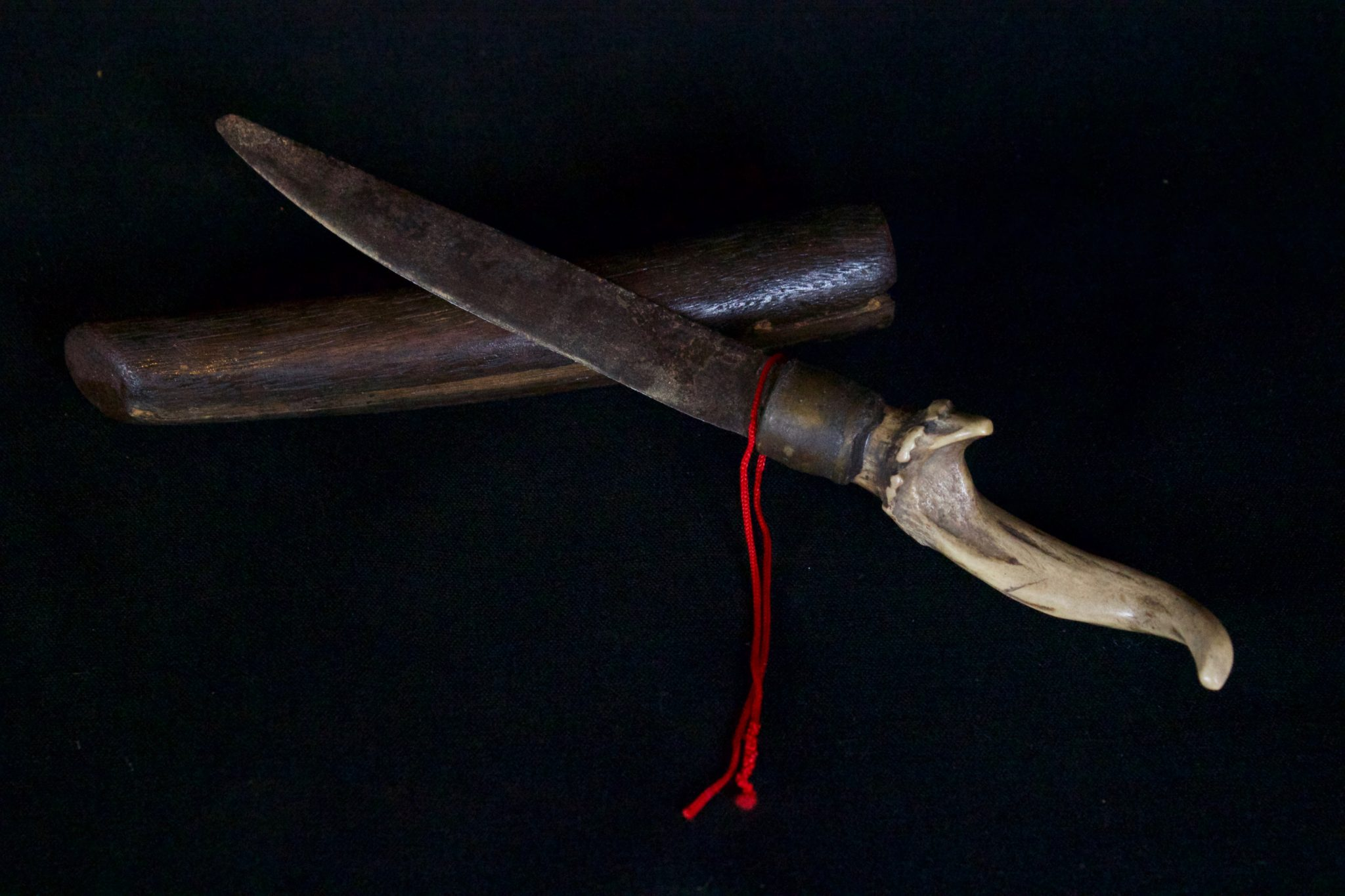 "Shaman's Personal Knife and Sheath, Vietnam, Yao people Late 19th c, Metal, horn, wood, 10"" x 1 ½"" x 1"", $580."