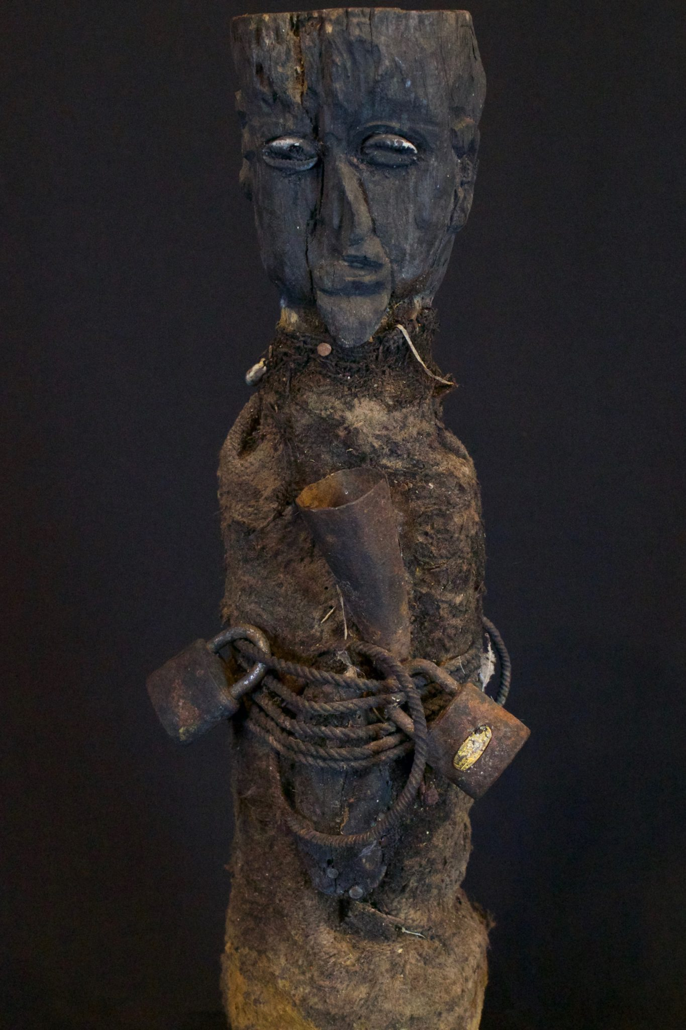 """Shaman Healing Fetish, Kalimantan, Borneo, Indonesia, Dayak Tribe Late 19th c, Wood, metal, shell, fiber netting. This is used by the shaman to contact the spirits for healing rituals. 16"""" x 6"""" x 5"""", $1800."""