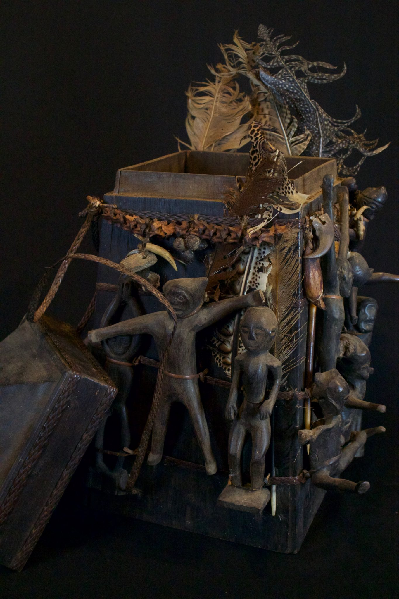"'Lupong Manang' Shaman's Medicine Carrier/Backpack with Healing Charm Figures (rare), East Kalimantan, Borneo, Indonesia, Dayak tribe. Late 19th to early 20th c, Wood, braided reed, feathers. The Shaman made his own medicine kit to contain items for healing, protections and predictions – such as special teeth, stones and other items. The figures on the exterior correspond to illnesses and other conditions or ailments. 17 ½"" x 13"" x 13"", $4800."