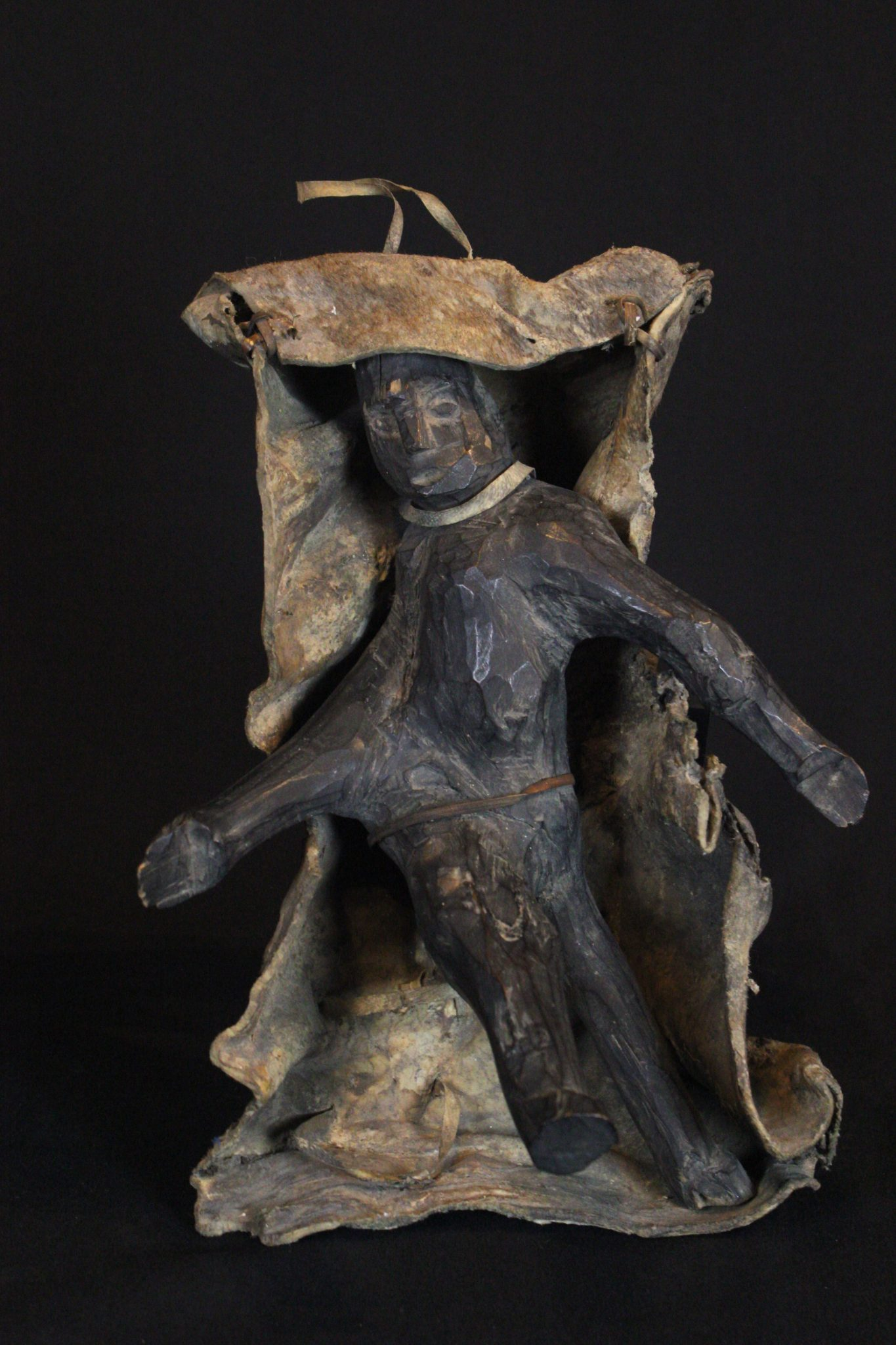 "Shaman Fetish Figure, Kalimantan, Borneo, Indonesia, Dayak tribe Early 20th c, Wood pigmented with soot, animal hide. Hung on the wall in the shaman's house and used for calling spirits and for healing rituals. 12"" x 8"" x 6"", $600."
