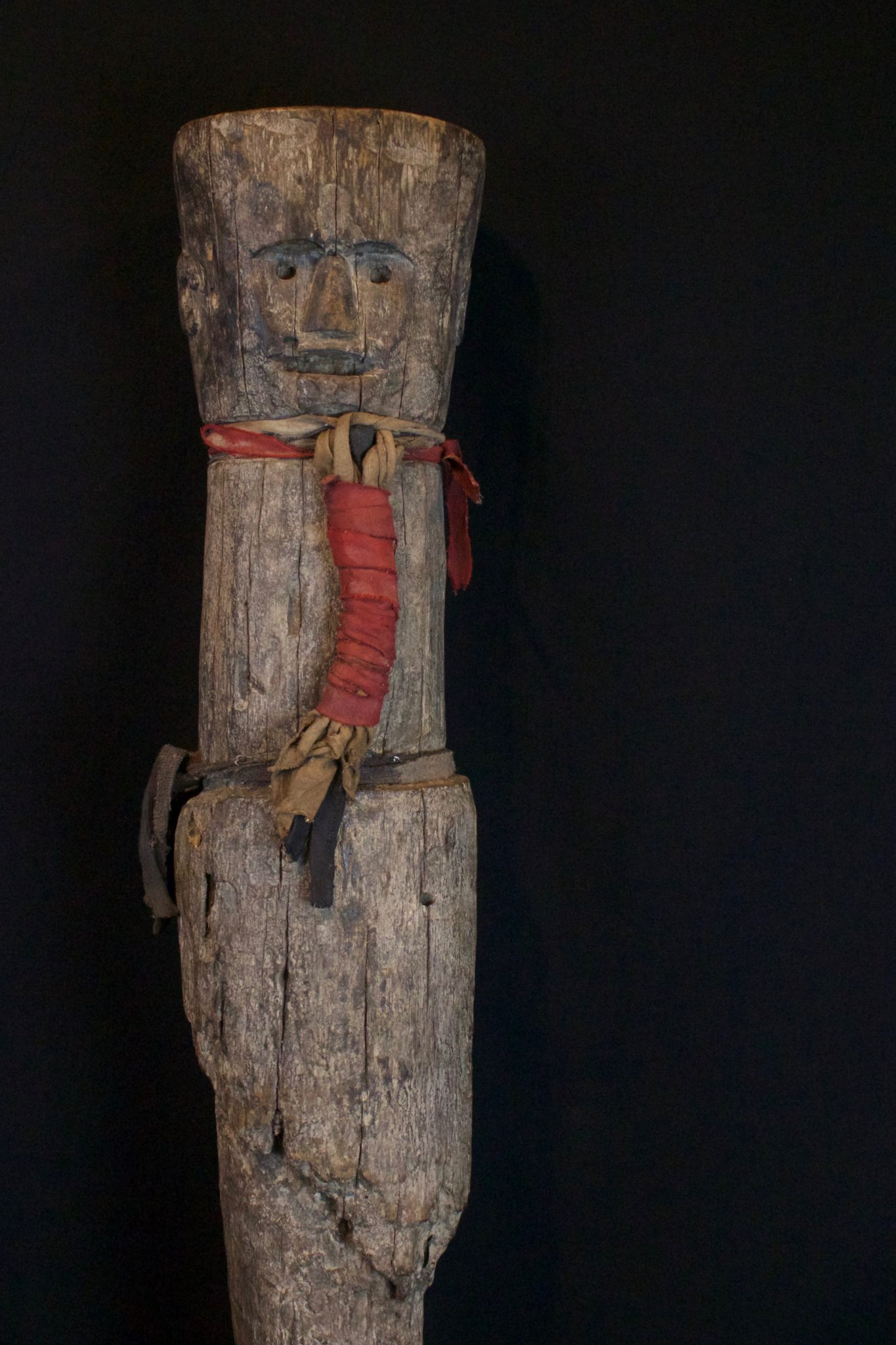 "Shaman Protector Figure, Kalimantan, Borneo, Indonesia, Dayak tribe, Early 20th c, Wood, cloth straps. Kept in the shaman's home for his protection. 28"" x 6"" x 5 ½"", $1900."