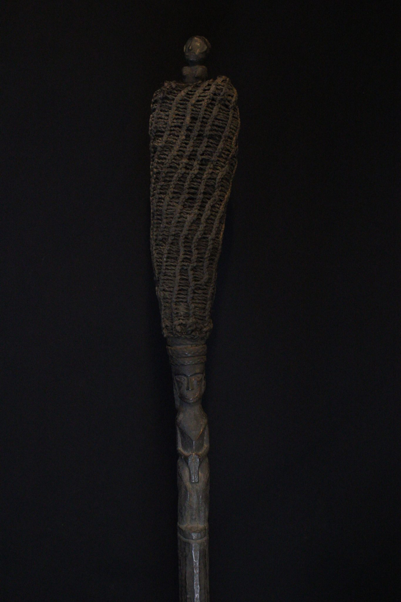 "Shaman's Magic Staff, Sumatra, Indonesia, Batak tribe, Early 20th c, Wood, plant fiber, rattan, pigmented with soot. Used for calling spirits and in healing rituals. 56 ½"" x 5"" x 4 ¾"", $1600."