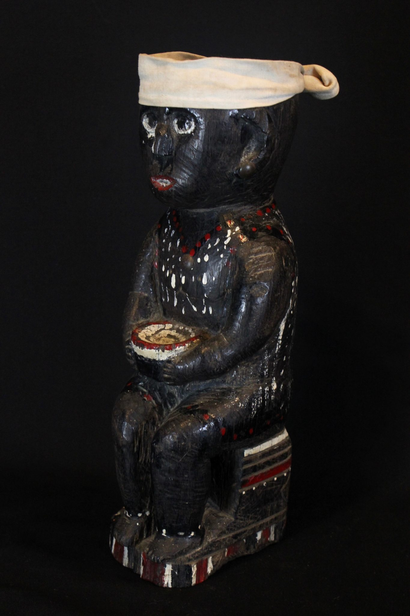 """Medicine Man Effigy Betel Nut Offering Figure, Kalimantan, Borneo, Indonesia, Dayak tribe, Early 20th c, Wood, cloth, paint Used to hold betel nuts as a ritual offering to the deities. 13"""" x 4 ½"""" x 5"""", $1200."""