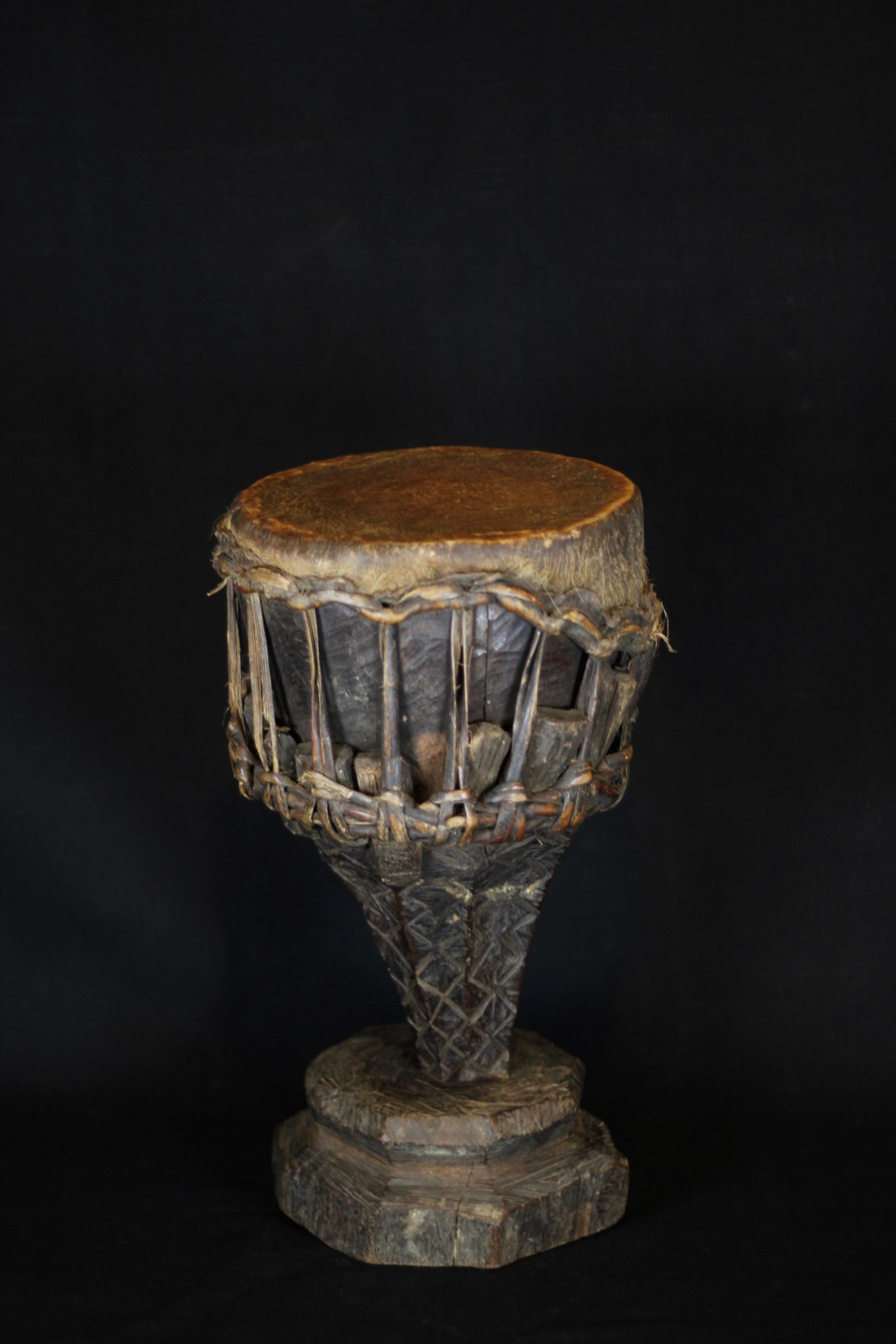 "Shaman Drum, Sumba Island, Indonesia, Early to mid 20th c, Animal skin stretched over wood, Used by shaman to initiate and maintain a trance state during rituals, 17 ½"" x 10 ½' x 10"", $490."