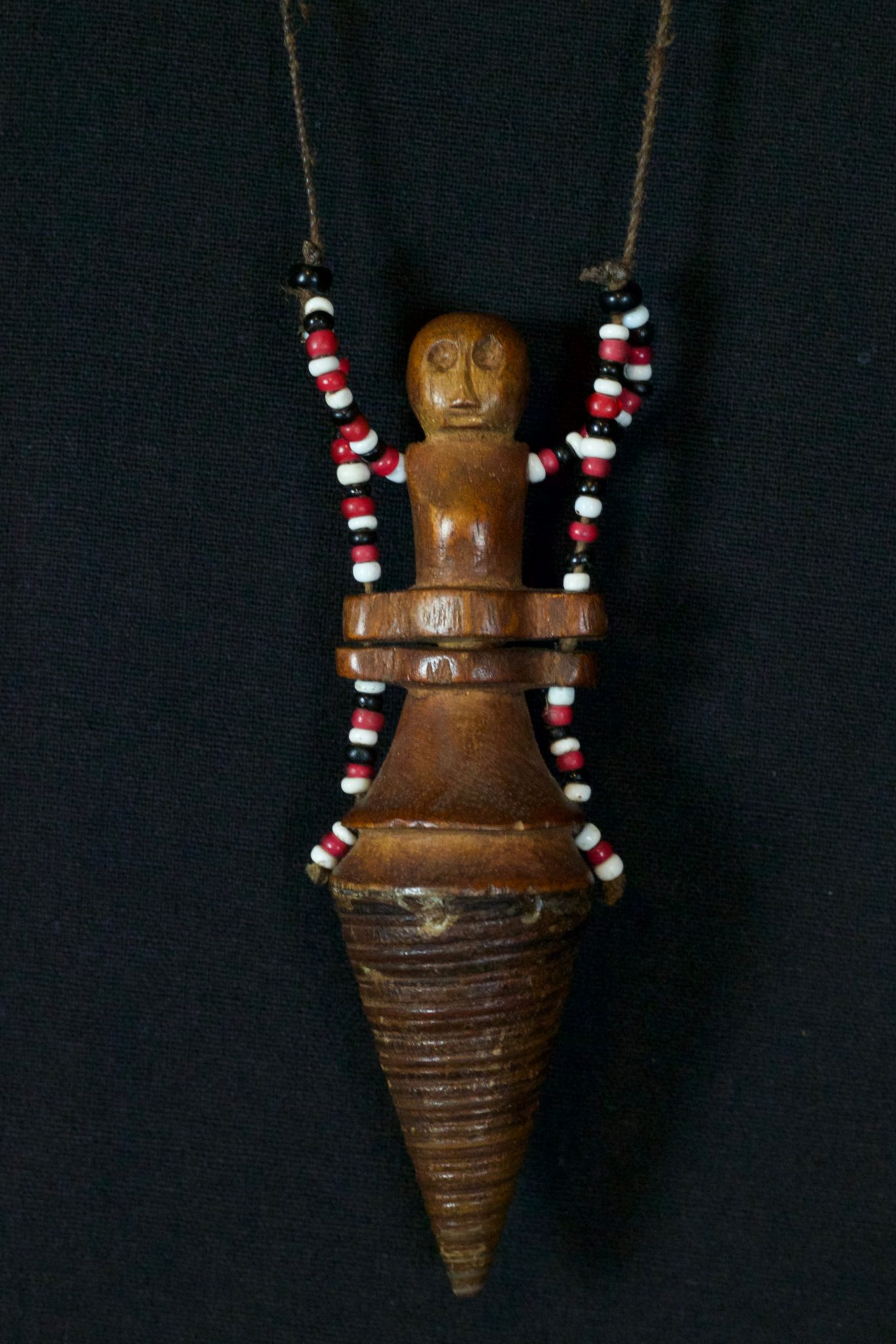"Shaman Healing Medicine Container Necklace, Alor Island, Timor Islands, Lesser Sunda Islands, Indonesia, Mid 20th c, Wood, beads, shell (Telescopium telescopium, or Horn snail spire). Used to hold medicine for healing rituals, 4 ½"" x 1 ½"" x 1 ¼"", $390."