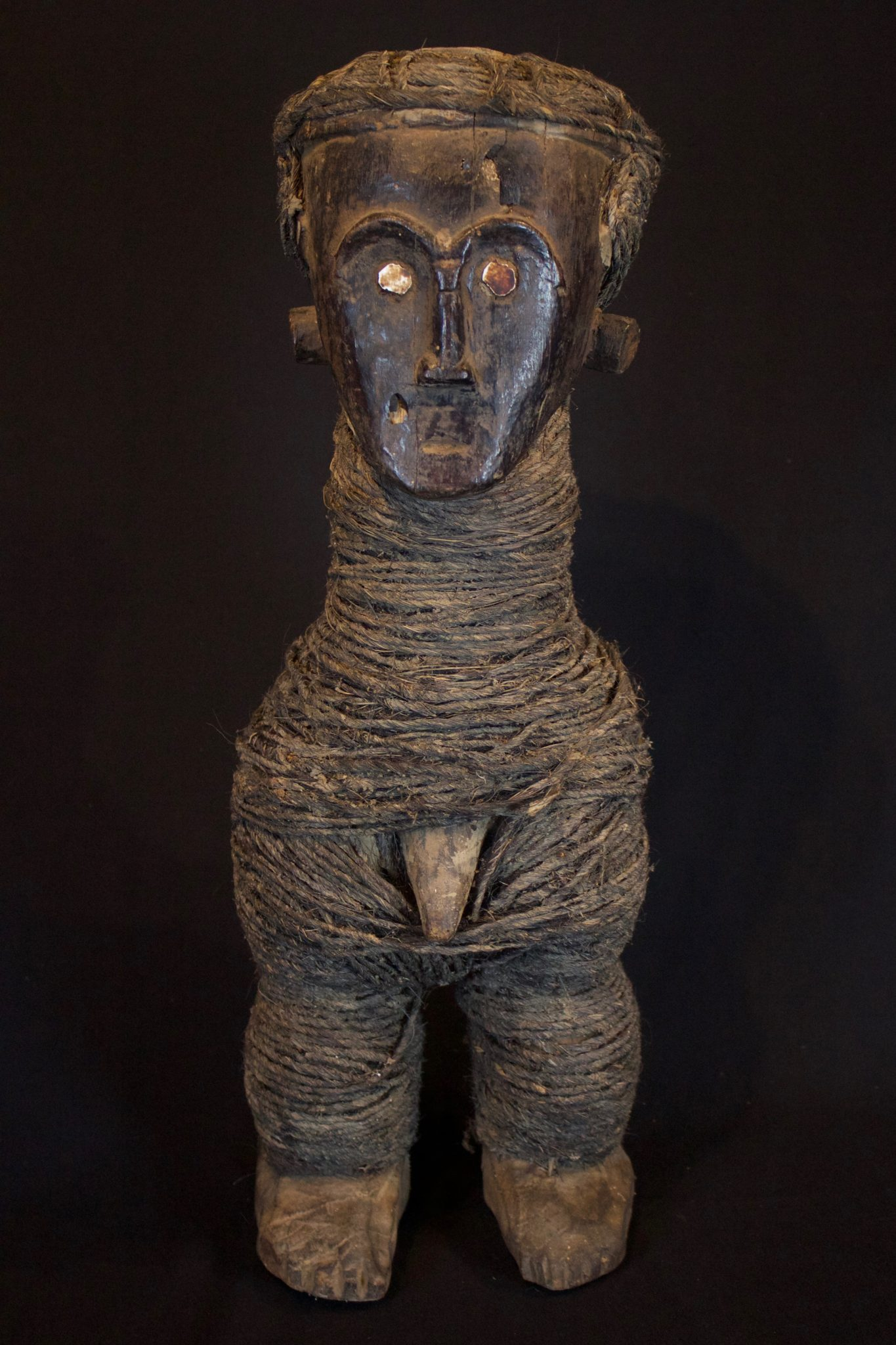"Shaman's Ritual Figure, Timor Island, Sunda Island, Indonesia, Niki Niki village Early 20th c, Wood, fiber cord, shell. Used by shaman to treat people as well as for other traditional rituals. 21"" x 7 ½"" x 6 ½"", $1400."