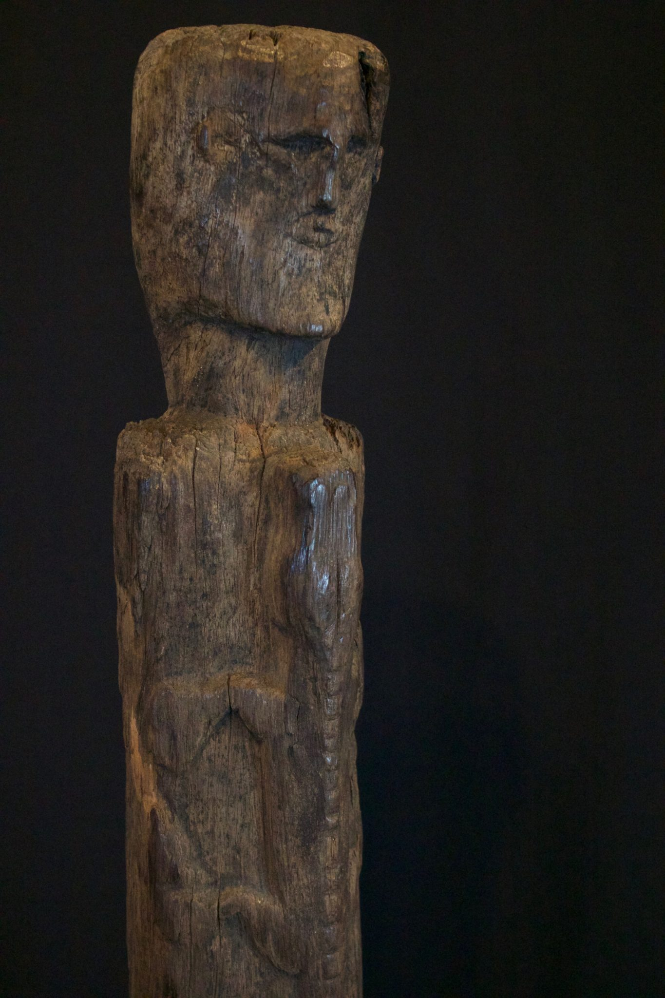 "Shaman Figure with Alligator, West Sumba Island, Lesser Sunda Islands, Indonesia, Kodi tribe, Mid to late 19th c, Wood, Used for protection rituals. 19 ¾"" x 4 ¼"" x 4"", $750."