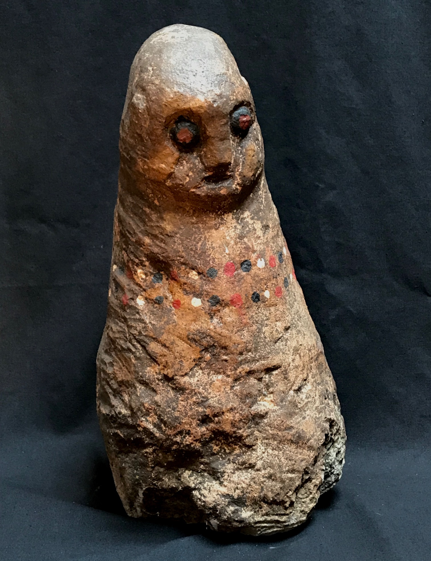 "Shaman Figure, Anakalang village, West Sumba Island, Indonesia, used for healing and protection and to predict auspicious dates for rituals, and possibly to find lost items. Early 20th c., stone, pigment, 15 1/4"" x 8"","
