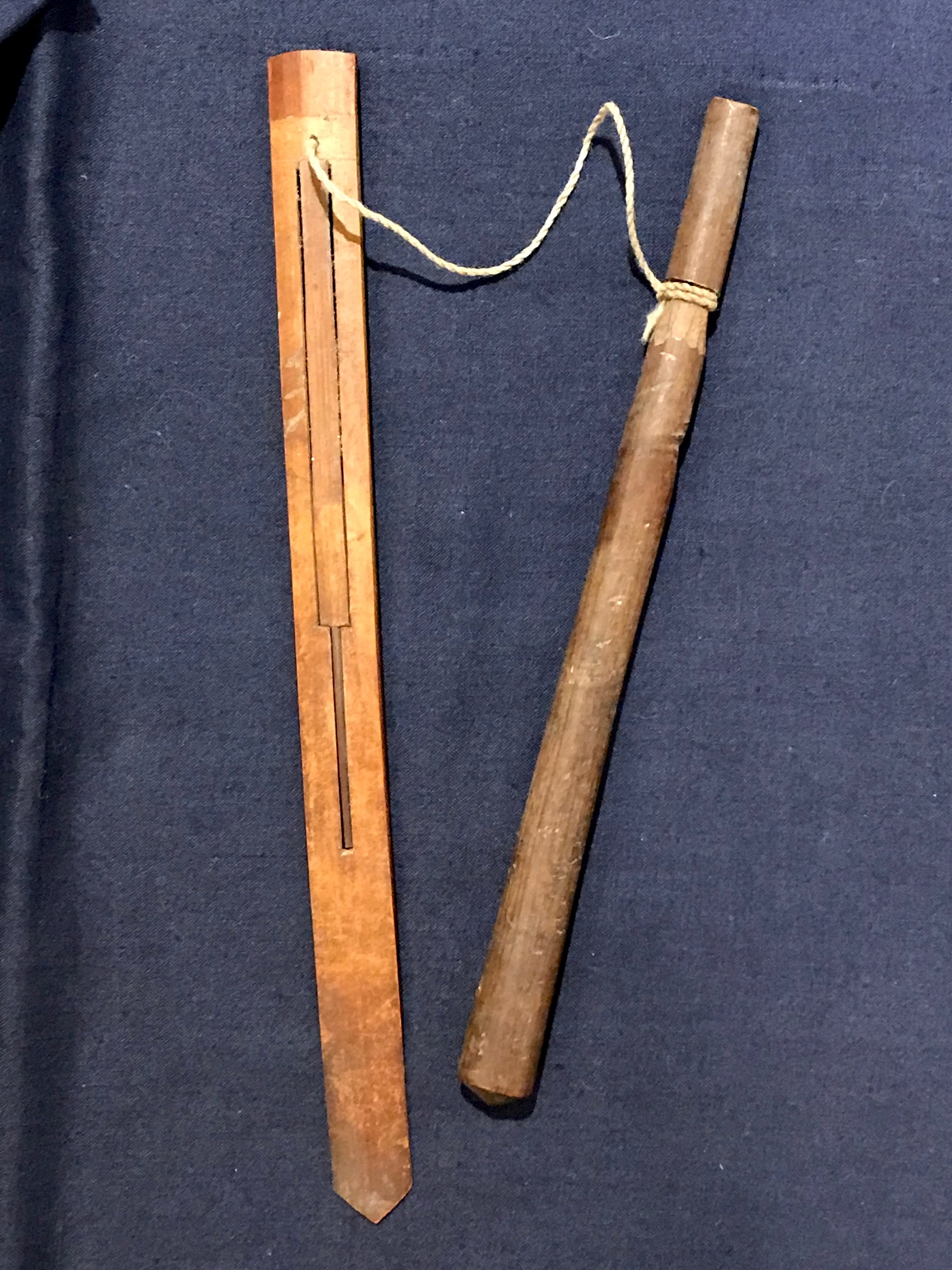 "Tribal Musical Instrument, Mouth Harp with pull stick, Sasak tribe, Lombok Island, Indonesia, Early to mid 20th c, bamboo, string, played by using the mouth as the resonating cavity and pulling the string to vibrate the bamboo. There are many traditional songs written for it. It has been referred to as a 'mind cleaner' Because it uses the mouth to resonate, it clears the brain of unclear thoughts. 7 1/2"" x 5/8"" x 1/8"", pull stick - 6 3/4"" x 3/8, $65., thedavidalancollection.com , solana beach, ca"