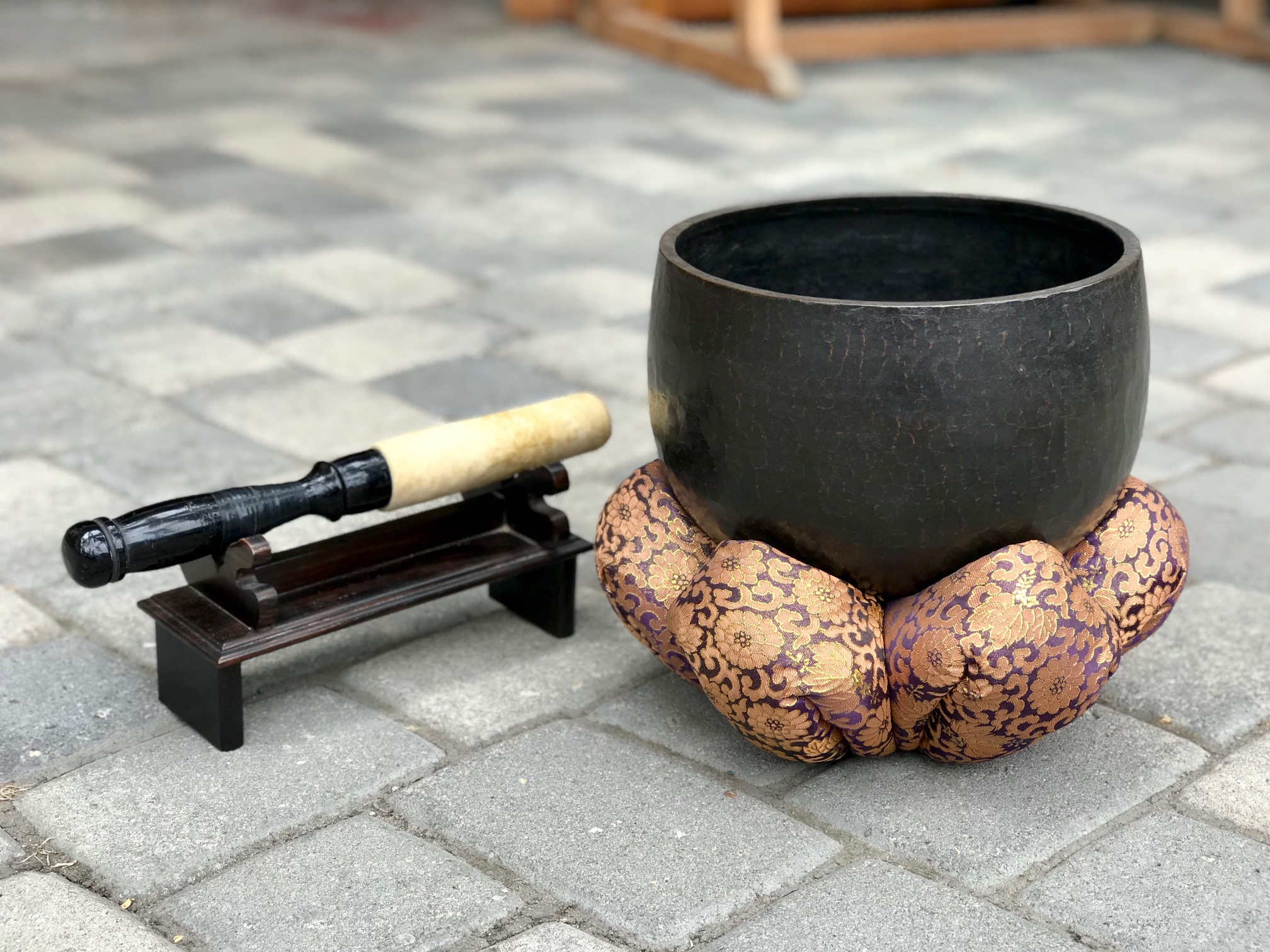 "Buddhist Temple Altar, Hammered Bronze, Singing Bowl and Cushion Stand, with Wooden and hyde Striker and Striker Stand Japan, 7"" x 10"" (10 1/2"" x 12 1/2"" with cuchion, striker - 13 1/2"" x 2"" (5 1/2"" tall with striker stand) $1250., thedavidalancollection.com , solana beach, ca,"