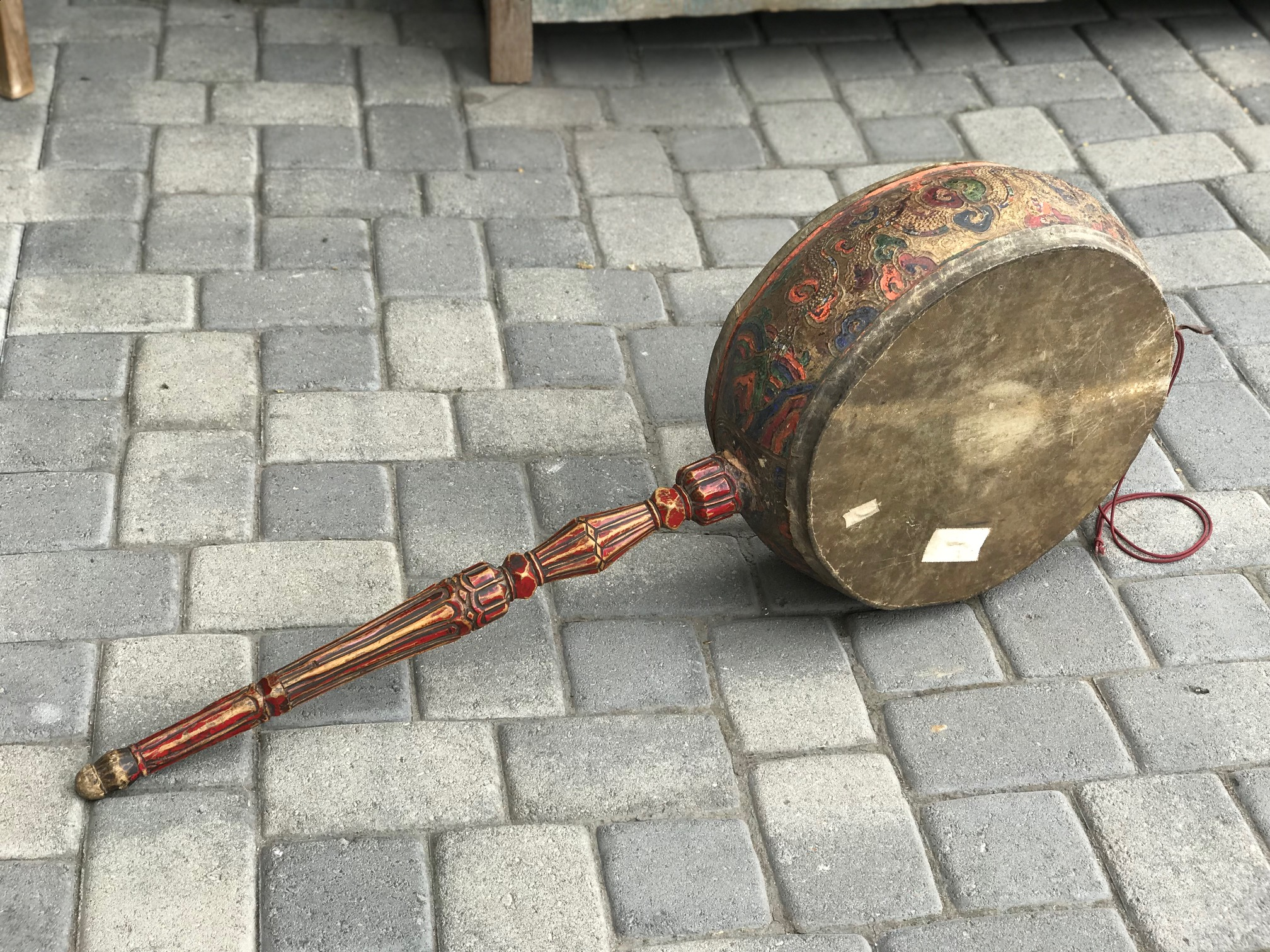 "Temple Drum, Tibet, 100+ years old, Wood, carved and painted polychrome by hand Iron, string, fabric and papier-mâché, decprated with Tibetan symbols. It is played with a curved stick and used for religious ceremonies and for meditation. 44 1/2"" x 16 1/2"" x 3 1/4"", $1100. thedavidalancollection.com , solana beach, ca"